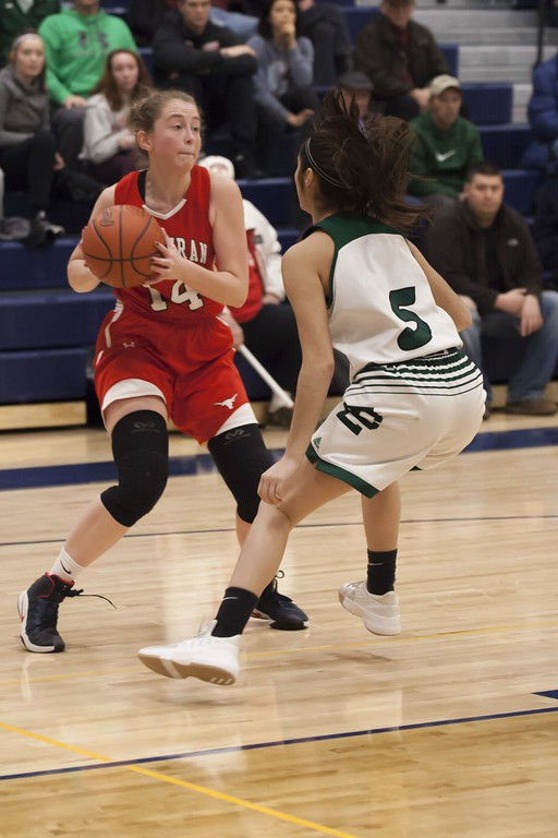 . Jen Forbus - The Morning Journal<br> With Elyria Catholic\'s Stephanie Griffin blocking her way, Lutheran West\'s Carleen Ellerbruch looks to her teammates for help on March 3.