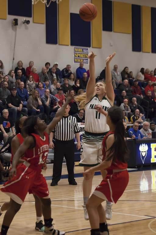 . Jen Forbus - The Morning Journal<br> Elyria Catholic\'s Meghan Allegretto takes a shot in the Panthers\' Division III North Ridgeveille District final win against the Lutheran West Longhorns on March 3.