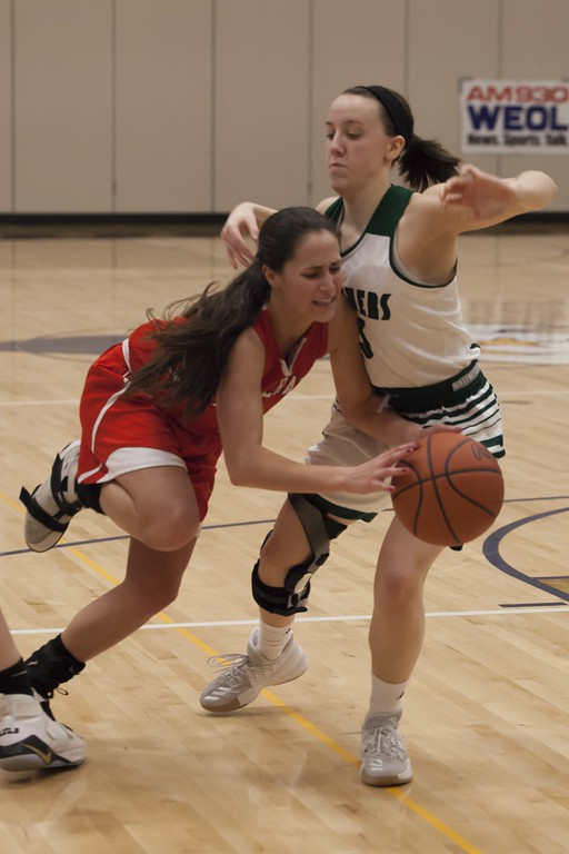 . Jen Forbus - The Morning Journal<br> Elyria Catholic\'s Regan Schill is a solid obstacle between Lutheran West\'s Abriana Rondin and the basket during the Division III North Ridgeville District final on March 3.