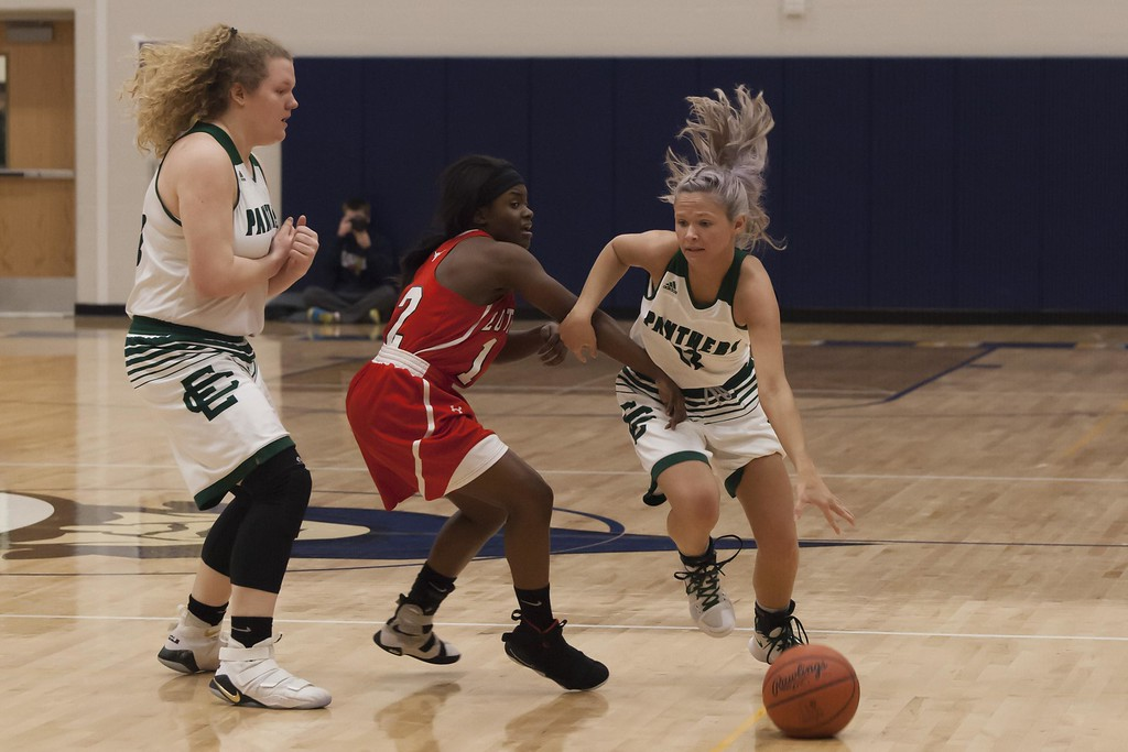 . Jen Forbus - The Morning Journal<br> Elyria Catholic\'s Abby Winnen, left, prepares a pick for teammate Faith Williams bringing the ball down court followed closely by Lutheran West\'s Raiyah Johnson on March 3.