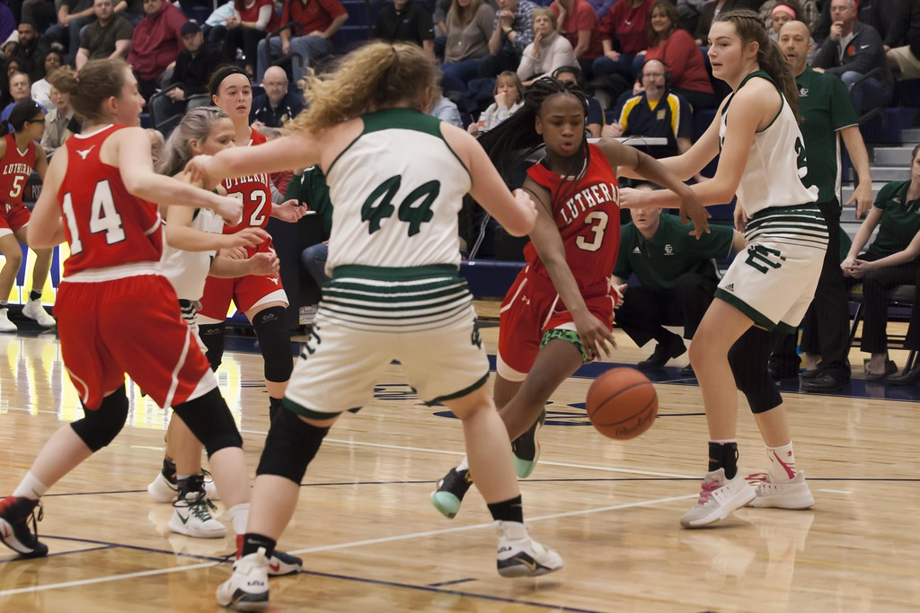 . Jen Forbus - The Morning Journal<br> Lutheran West\'s Larnae Vance finds a hole in the Elyria Catholic defense and dribbles through on her way to the hoop on March 3.
