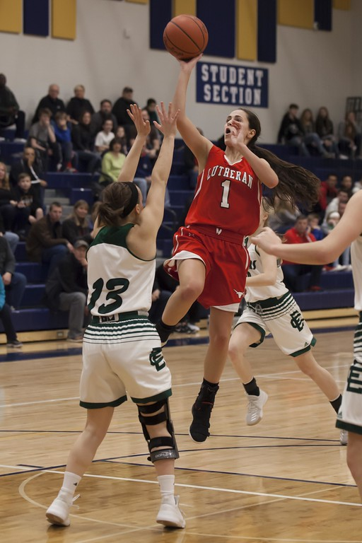 . Jen Forbus - The Morning Journal<br> Lutheran West\'s Abriana Rondin throws a shot up and over defense from Elyria Catholic\'s Regan Schill on March 3.
