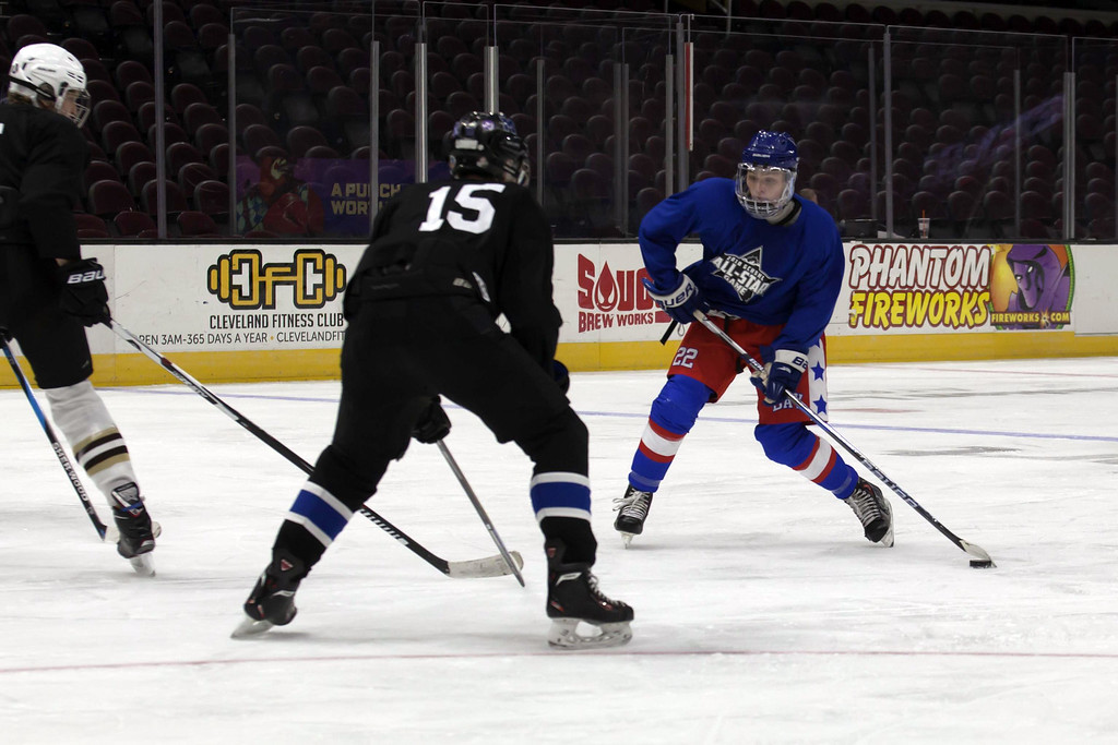 . Jen Forbus - The Morning Journal Bay\'s Jake Gaudino squares off against Midview\'s Heath Naso in the consolation round, Blue Team vs. Black Team, of the GCHSHL All-Star hockey game on March 4 at the Quicken Loans Area.