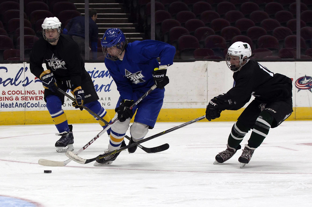 . Jen Forbus - The Morning Journal In the consolation round, Westlake\'s Sam Mansour (right), playing for the Black Team, looks for an opportunity to snag the puck from a member of the Blue Team during the GCHSHL All-Star hockey game on March 4 at the Quicken Loans Area.
