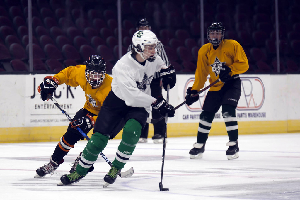 . Jen Forbus - The Morning Journal Elyria Catholic\'s Ryan Sustersic turns the puck toward the White goal in the championship round of the GCHSHL All-Star hockey game on March 4 at the Quicken Loans Area.
