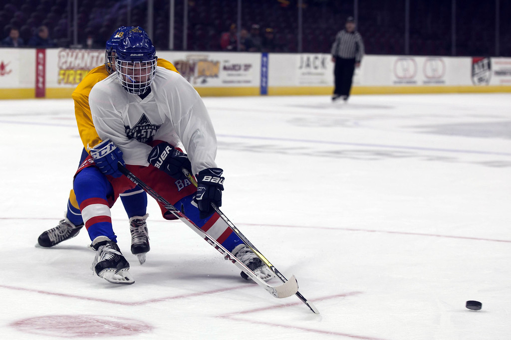 . Jen Forbus - The Morning Journal Bay\'s Will Kenney keeps himself between the puck and Sam Cameratta of Notre Dame-Cathedral Latin in the championship round of the GCHSHL All-Star hockey game on March 4 at the Quicken Loans Area.
