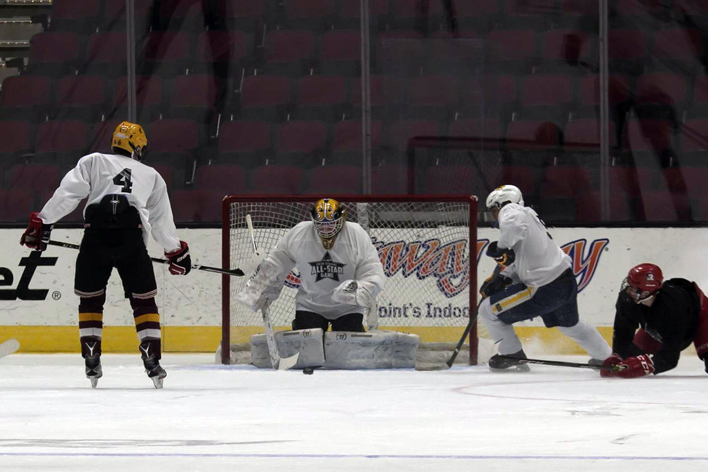 . Jen Forbus - The Morning Journal  Taking over goalie duties in the second half of the White v. Black first round, Avon\'s Danny Fielding saves a shot from Chris Heim\'s (Kent Roosevelt) during the GCHSHL All-Star hockey game on March 4 at the Quicken Loans Area.