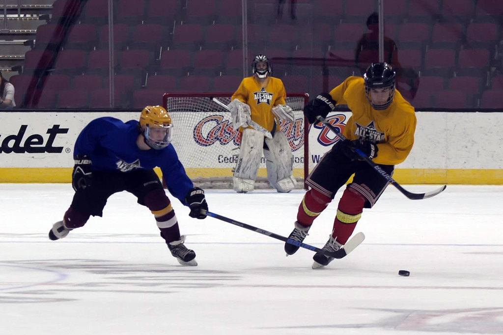 . Jen Forbus - The Morning Journal Jared Aslaksen of Avon Lake tries to take possession of the puck from Will Morgan of Brecksville in the second round of the GCHSHL All-Star hockey game on March 4 at the Quicken Loans Area.