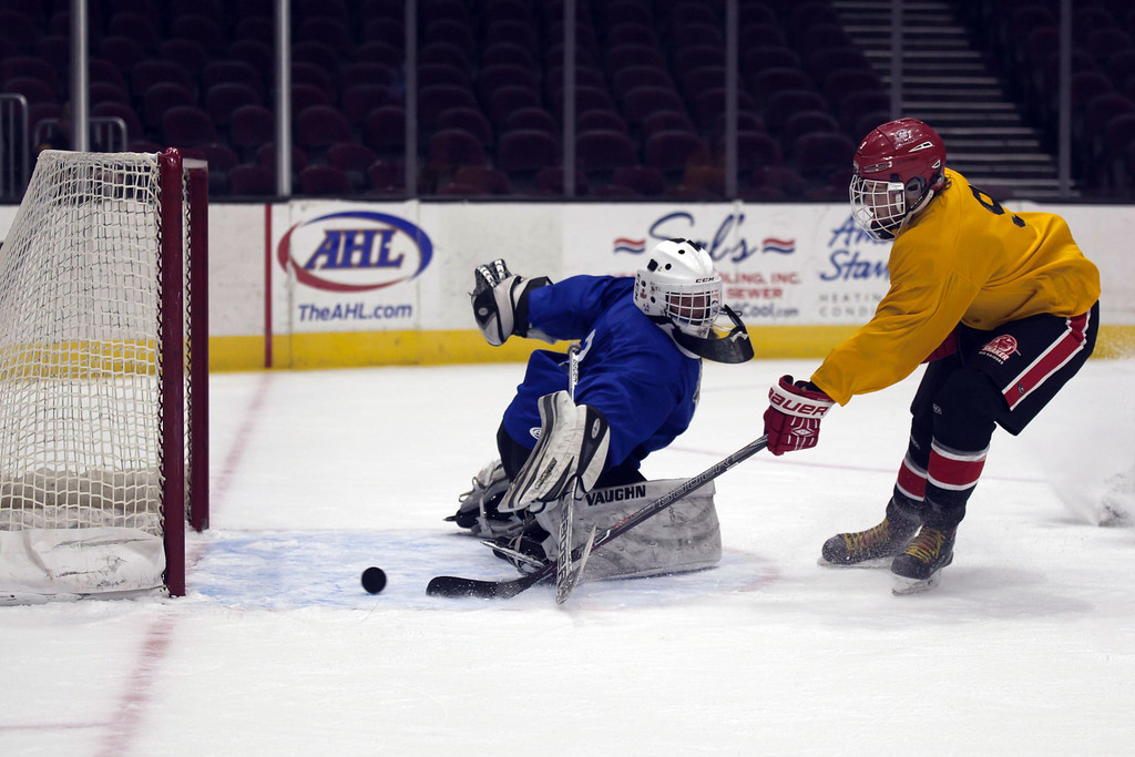 . Jen Forbus - The Morning Journal Shaker Heights\' Stephen Straffon gets the puck past Avon Lake goalie Cameron Stepka in the second round of the GCHSHL All-Star hockey game on March 4 at the Quicken Loans Area.