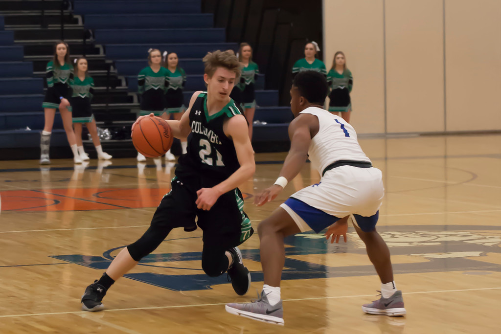 . Jen Forbus - The Morning Journal<br> Columbia\'s Jake Kile looks to get around Lutheran East\'s David Gulley on March 5.
