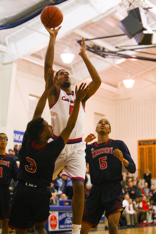 . David Turben - The News-Herald 2018 - Basketball - Orwell District - Cornerstone vs JFK.  Cornerstone defeated JFK 72-56.  Cornerstone\'s Kendall Saunders (0) goes up for short jump shot.