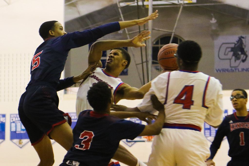 . David Turben - The News-Herald 2018 - Basketball - Orwell District - Cornerstone vs JFK.  Cornerstone defeated JFK 72-56.  Cornerstone\'s Michael Bothwell (3) fights to get a shot off over the defense by JFK\'s Tyrel James (5).