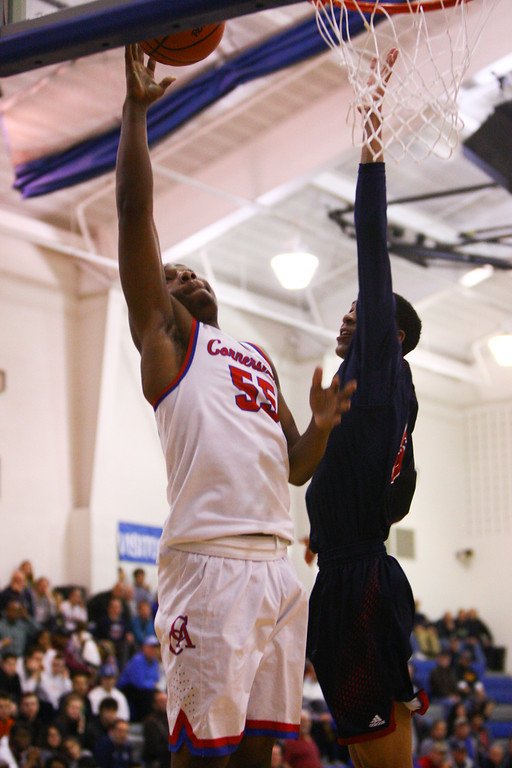 . David Turben - The News-Herald 2018 - Basketball - Orwell District - Cornerstone vs JFK.  Cornerstone defeated JFK 72-56.  Cornerstone\'s Jeremy Owens (4) goes in for a layup.