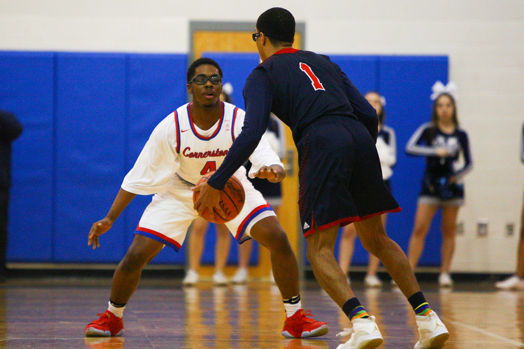 . David Turben - The News-Herald 2018 - Basketball - Orwell District - Cornerstone vs JFK.  Cornerstone defeated JFK 72-56.  Cornerstone\'s Jeremy Owens (4) sets up on defense against JFK\'s Willie Williams (1)