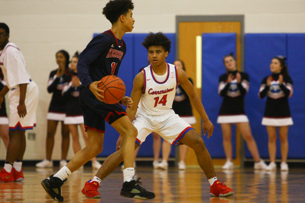 . David Turben - The News-Herald 2018 - Basketball - Orwell District - Cornerstone vs JFK.  Cornerstone defeated JFK 72-56.  Cornerstone\'s Ricky Adams (14) sets up on defense.