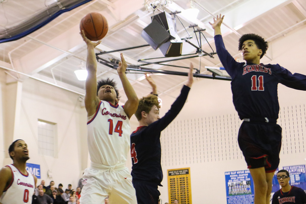 . David Turben - The News-Herald 2018 - Basketball - Orwell District - Cornerstone vs JFK.  Cornerstone defeated JFK 72-56.  Cornerstone\'s Ricky Adams (14) goes up for a layup with JFK\'s Sharrod Taylor (11) coming in for a block.