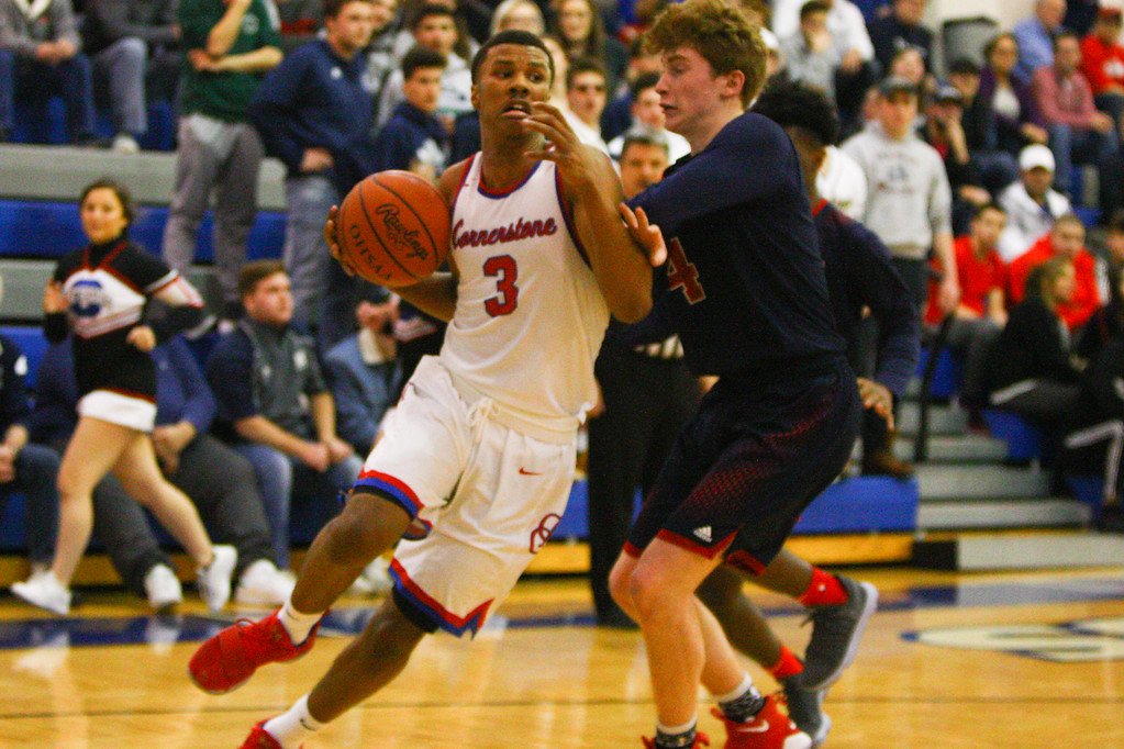 . David Turben - The News-Herald 2018 - Basketball - Orwell District - Cornerstone vs JFK.  Cornerstone defeated JFK 72-56.  Cornestone\'s Michael Bothwell (3) turns the corner to drive the baseline against JFK\'s Gianni Eaton (4).