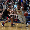 Randy Meyers - The Morning Journal<br /> Oberlin guard Zion Hicks drives by  Evan Ringer of Rittman during the second quarter on March 6.