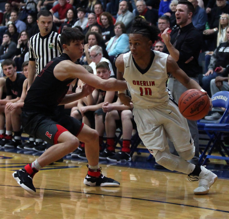 . Randy Meyers - The Morning Journal Oberlin guard Zion Hicks drives by  Evan Ringer of Rittman during the second quarter on March 6.