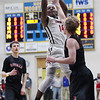 Randy Meyers - The Morning Journal<br /> Oberlin's Devin Yarber shoots over Kaleb Bauman of Rittman during the second quarter on March 6.