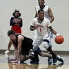 Randy Meyers - The Morning Journal<br /> Oberlin's Justin Smith takes the  ball away from Jacob Stuart of Rittman and starts a fast break during the second quarter on March 6.