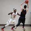 Randy Meyers - The Morning Journal<br /> Rittman's Jacob Stuart looks to pass over Devin Yarber of Oberlin during the first quarter on March 6.