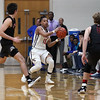 Randy Meyers - The Morning Journal<br /> Oberlin guard Zion Hicks looks to pass over the full-court pressure applied by the Rittman defense during the first quarter on March 6.