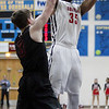 Randy Meyers - The Morning Journal<br /> Oberlin center Donald Johnson shoots and scores over Rittman's Connor Stuart during the second quarter on March 6.