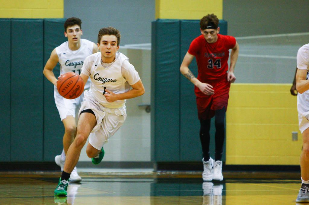 . David Turben - The News-Herald 2018 - Basketball - Ashtabula District - Edgewood vs Lake Catholic.  Lake Catholic defeated Edgewood 55-46.  Lake Catholic\'s Brandon Horton (1) brings the ball up court on a fast break.