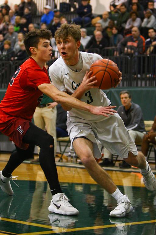 . David Turben - The News-Herald 2018 - Basketball - Ashtabula District - Edgewood vs Lake Catholic.  Lake Catholic defeated Edgewood 55-46.  Lake Catholic\'s Sean Fitzgerald (3) drives the baseline.