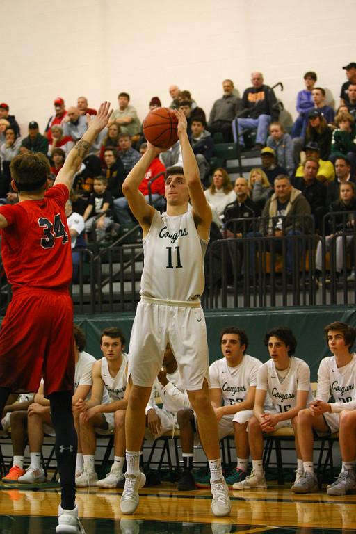 . David Turben - The News-Herald 2018 - Basketball - Ashtabula District - Edgewood vs Lake Catholic.  Lake Catholic defeated Edgewood 55-46.  Lake Catholic\'s Luka Eller (11) puts up a three-point shot.