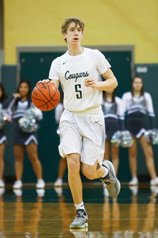. David Turben - The News-Herald 2018 - Basketball - Ashtabula District - Edgewood vs Lake Catholic.  Lake Catholic defeated Edgewood 55-46.  Lake Catholic\'s Luke Frazier (5) brings the ball up court.