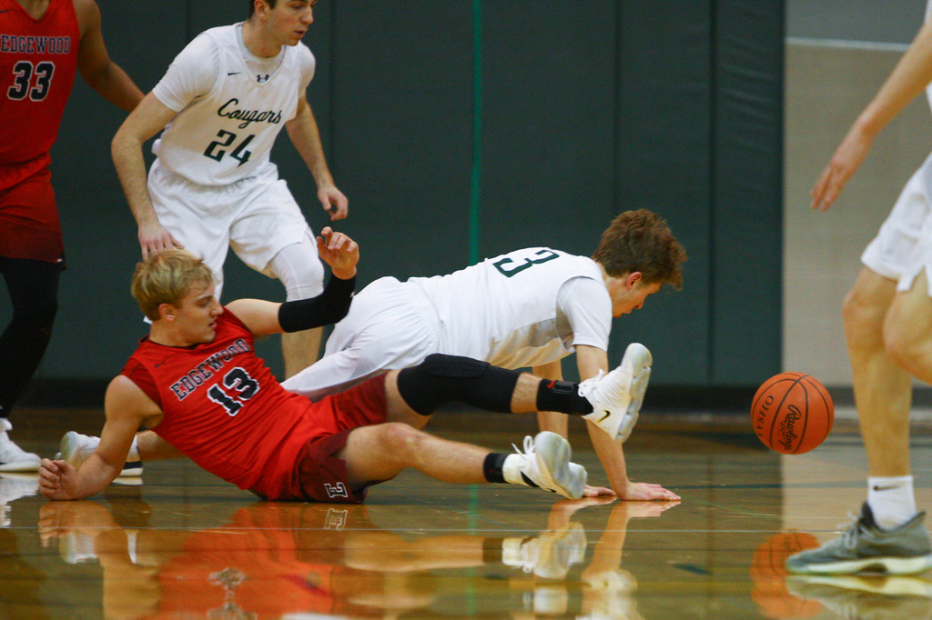 . David Turben - The News-Herald 2018 - Basketball - Ashtabula District - Edgewood vs Lake Catholic.  Lake Catholic defeated Edgewood 55-46.  Lake Catholic\'s Sean Fitzgerald (3) and Edgewood\'s Aaron Anderson (13) fight for a loose ball.