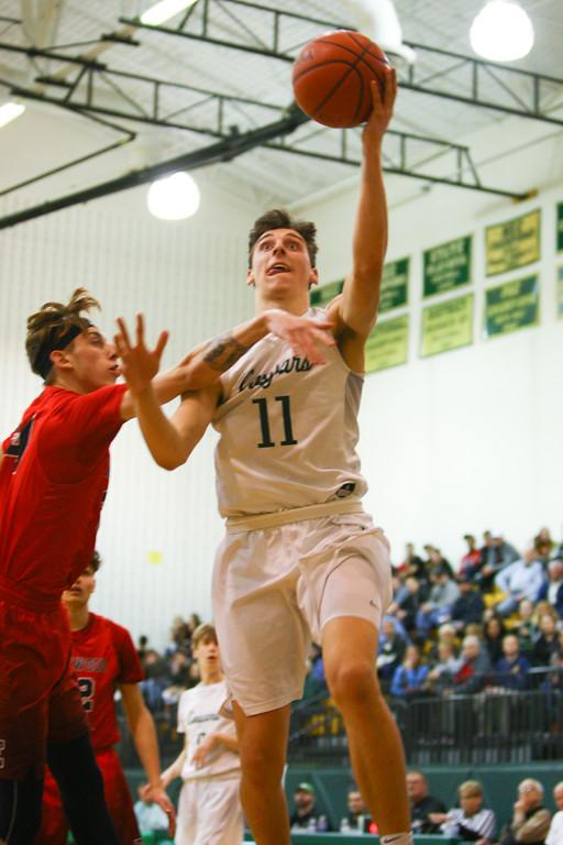 . David Turben - The News-Herald 2018 - Basketball - Ashtabula District - Edgewood vs Lake Catholic.  Lake Catholic defeated Edgewood 55-46.  Lake Catholic\'s Luka Eller (11) puts up a layup.