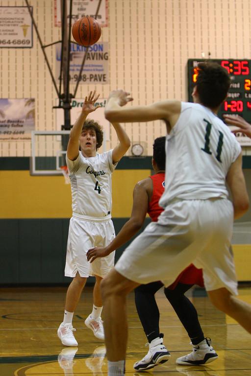 . David Turben - The News-Herald 2018 - Basketball - Ashtabula District - Edgewood vs Lake Catholic.  Lake Catholic defeated Edgewood 55-46.  Lake Catholic\'s Brenden Newmark (4) puts up a three-point shot.