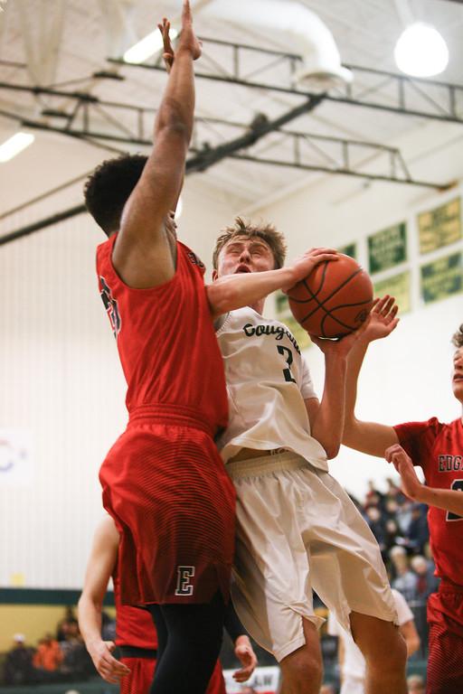 . David Turben - The News-Herald 2018 - Basketball - Ashtabula District - Edgewood vs Lake Catholic.  Lake Catholic defeated Edgewood 55-46.  Lake Catholic\'s Sean Fitzgerald (3) puts up a tough shot udner the basket.