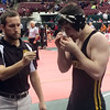 John Kampf - The News-Herald<br /> Riverside's Alex Farenchak with assistant coach Justin Toth during the first day of the state wrestling tournament on March 9 in Columbus.