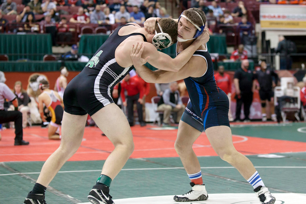 . Jen Forbus - The Morning Journal<br> Matthew Cover of Bay wraps up Colin McNamara of Aurora in a Division II 195-pound bout of the state tournament on March 9.
