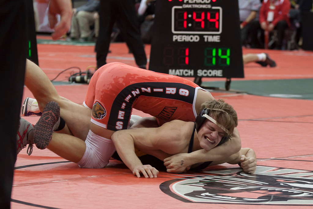 . Jen Forbus - The Morning Journal<br> Josh Jaeckin of Olmsted Falls struggles in his Division I 145-pound bout with Michael North of Wadsworth during the state tournament on March 9.
