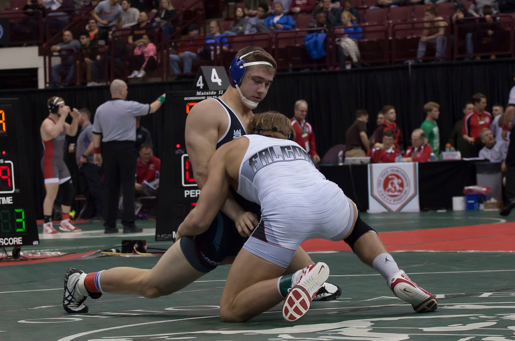 . Jen Forbus - The Morning Journal<br> Bay\'s Matt Cover works gain the advantage over St. Paris Graham\'s Gage Braun during a Division II 195-pound semifinal match during the state tournament on March 9.