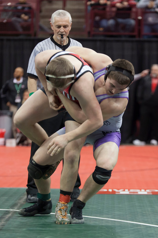 . Jen Forbus - The Morning Journal<br> Justin Ocheltree of Keystone takes down Norton\'s C.J. Willaims during a Divsion II consolation quarterfinal match at the state tournament on March 9.