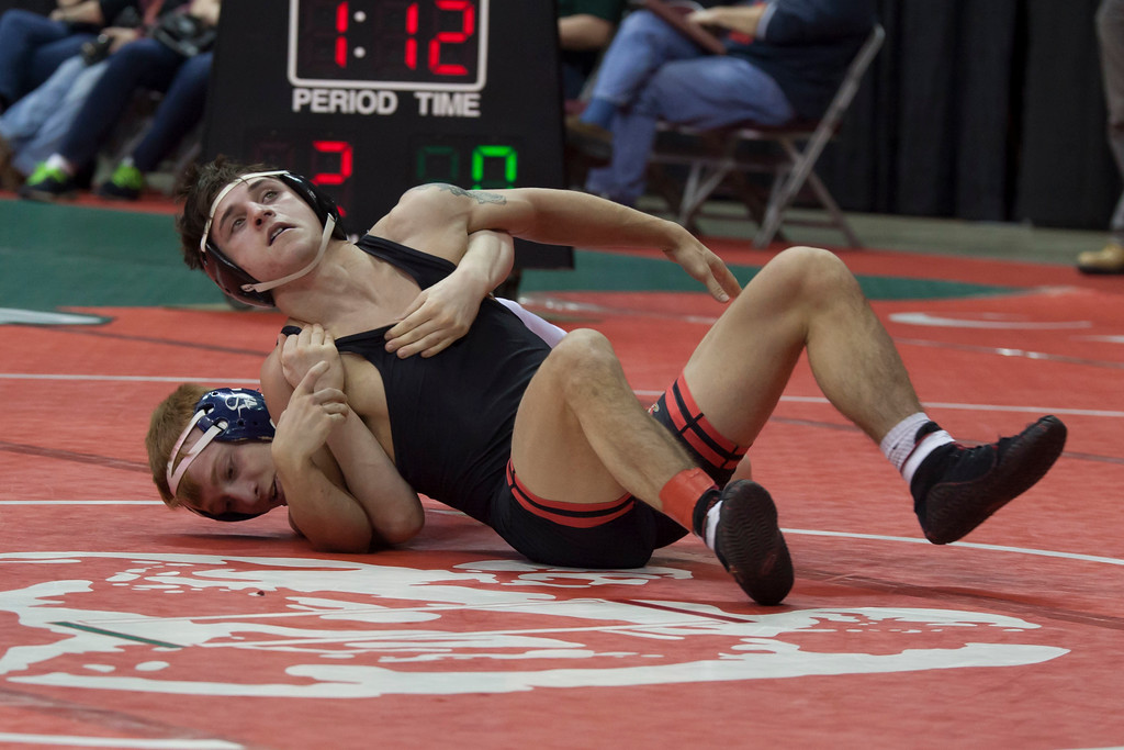 . Jen Forbus - The Morning Journal<br> Brendon Fenton of Elyria vies with Jake Canitano of Solon in a Division I 120-pound match of the state tournament on March 9.