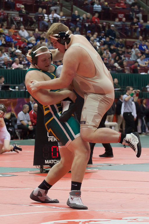 . Jen Forbus - The Morning Journal<br> Matt Lee of Amherst keeps solid footing in his bout with Dawson Shaw of Columbus West in the state tournament on March 9.