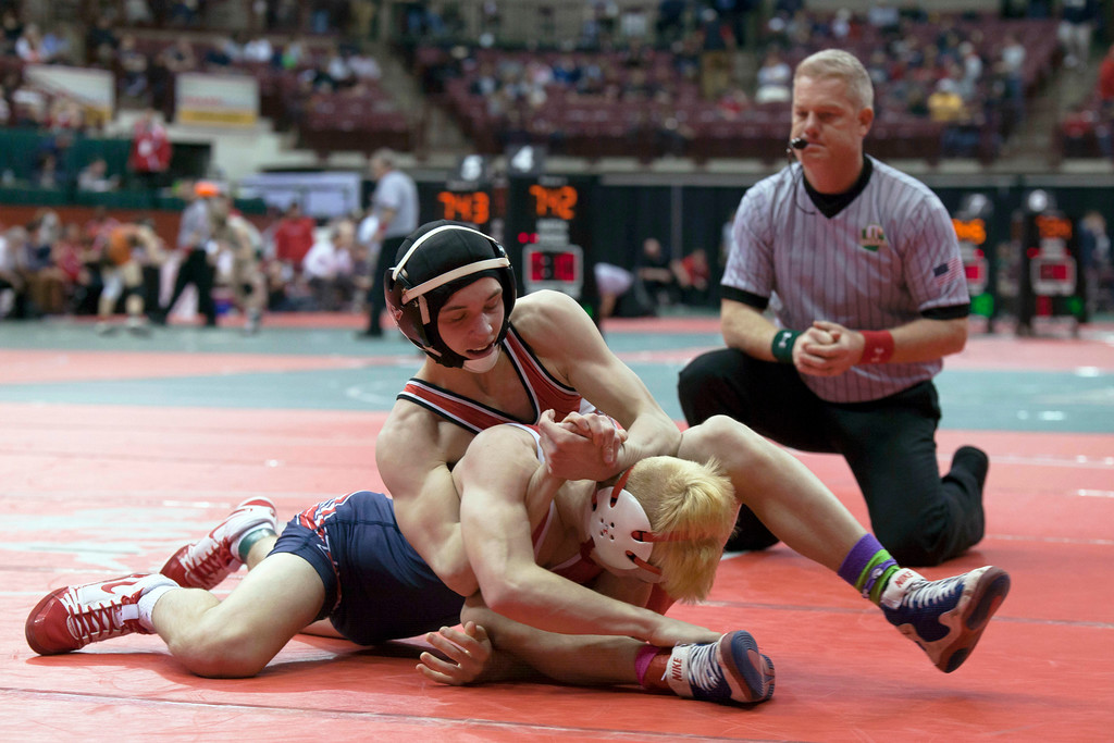 . Jen Forbus - The Morning Journal<br> Matt Kaufman of Fairview wrestles in a consolation round match on March 9.