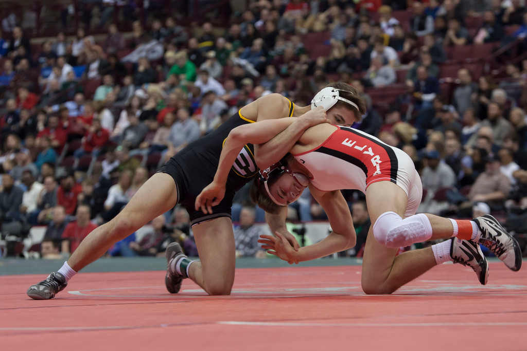 . Jen Forbus - The Morning Journal<br> Despite a hard fight, Elyria\'s Mick Burnett fell to Lakewood St Edward\'s Bryce Hepner in the finals round of the Division 1 126-pound weight class at state wrestling tournament Saturday night.