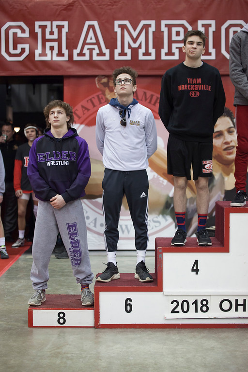 . Jen Forbus - The Morning Journal<br> Micheal Shaw of Olmsted Falls takes his place on the winner\'s podium Saturday night at the state wrestling tournament finals.
