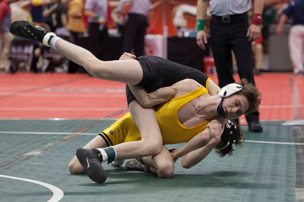 . Jen Forbus - The Morning Journal<br> Olmsted Falls\' Michael Shaw put up a good fight but fell to St. Edward\'s Richard Delsanter in the Division I 106-pound  bout for fifth place at the state tournament on March 10.