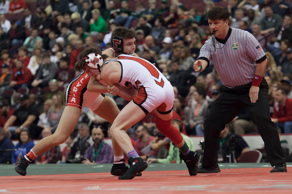 . Jen Forbus - The Morning Journal<br> Dylan Shawver of Elyria faces off against Lucas Byrd of Cincinnati LaSalle in the Division I Finals round of the 113-pound weight division  at the state wrestling tournament.