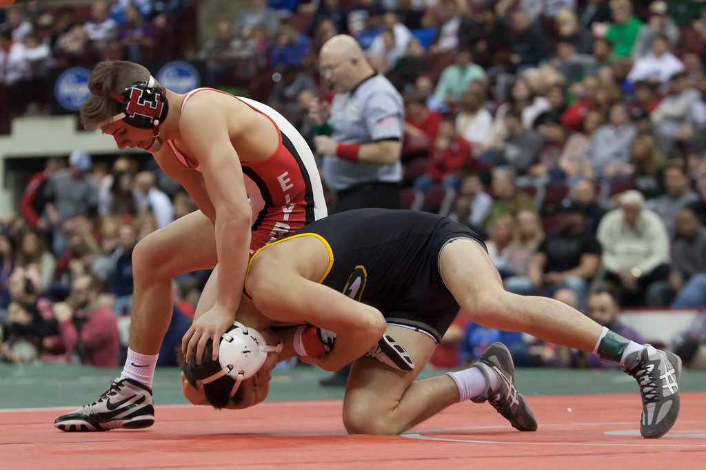 . Jen Forbus - The Morning Journal<br> Mick Burnett of Elyria tries to keep the upper hand in his finals bout with Bryce Hepner of St. Edward.