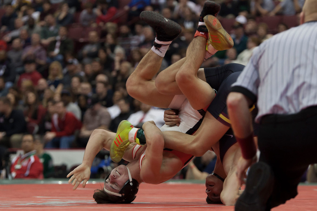 . Jen Forbus - The Morning Journal<br> Brendon Fenton of Elyria and Julian Tagg of Brecksville-Broadview Heights flip in the Division I Finals round of the 120-pound weight division at the state wrestling tournament.